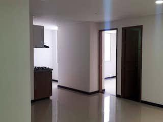 Un refrigerador congelador blanco sentado dentro de una cocina en Apartamento en Venta SANTA ISABEL