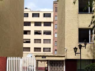 Un banco de parque en frente de un edificio en Apartamento en venta en Barrio Nicolás De Federman de 2 hab.