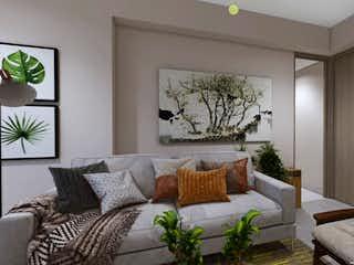 Una sala de estar llena de muebles y una planta en maceta en Vivarí torre 2
