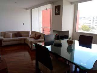 Una sala de estar llena de muebles y una televisión de pantalla plana en Venta Apartamento Batan