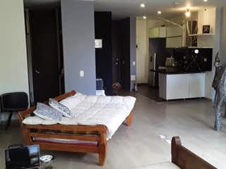 Una sala de estar llena de muebles y una televisión de pantalla plana en BOGOTA, D.C. VENDO LOFT EN BOSQUE IZQUIERDO