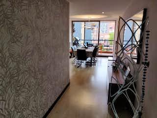 Una sala de estar llena de muebles y una ventana en BOGOTA, VENDO DUPLEX EN SAN PATRICIO
