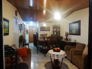 Una sala de estar llena de muebles y una gran ventana en VENTA APARTAMENTO LA CAMPIA SUBA