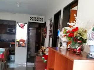 Una sala de estar llena de muebles y un árbol de navidad en Casa en Venta BELEN
