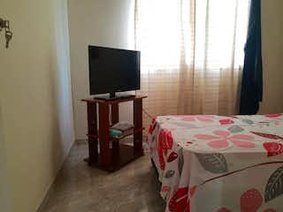 Un dormitorio con una cama y un televisor en Apartamento en venta en Santa María de 3 habitaciones