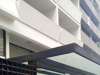 Un parquímetro delante de un edificio en VENTA DEPARTAMENTO LOMAS DE CHAPULTEPEC, COFRE DE PEROTE.