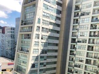 Un edificio alto con un edificio grande en el fondo en VENTA DEPARTAMENTO GRAND POLANCO