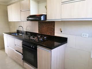 Una cocina con una estufa y un fregadero en Apartamento en venta en Belén Centro con Piscina...