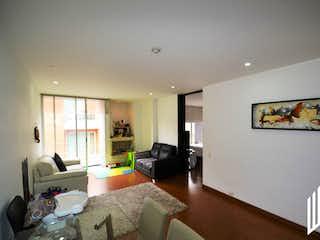 Una sala de estar llena de muebles y una televisión de pantalla plana en APARTAMENTO PARA  VENTA EN SANTA BRBARA