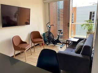 Una sala de estar llena de muebles y una ventana en MODERNO APARTAESTUDIO EN CHICO NAVARRA VENTA