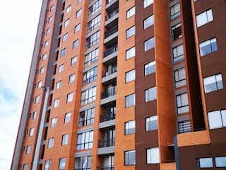 Un edificio alto sentado al lado de un edificio alto en PARA ESTRENAR APARTAESTUDIO BARRANCAS - VENTA
