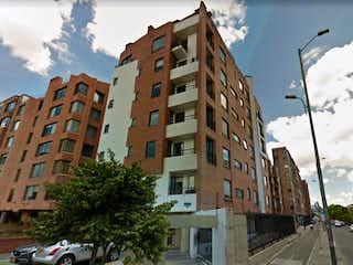Un edificio alto sentado al lado de una calle en APARTAMENTO EN CALLEJA VENTA