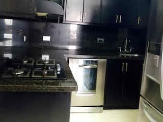Una cocina con una estufa de acero inoxidable y nevera en Apartamento en venta en Hospital Mental de 3 hab. con Balcón...