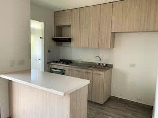 Una cocina con una estufa de fregadero y armarios en Apartamento en venta en La Tablacita, 60m² con Zonas húmedas...