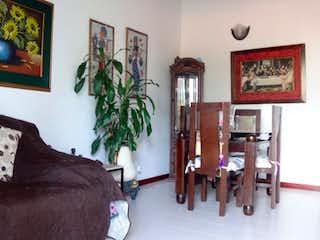 Una sala de estar llena de muebles y una pintura en Vendo apartamento sector Santa Monica, Medellin