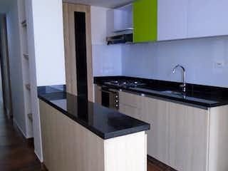 Una cocina con un fregadero y una estufa en APARTAESTUDIO EN VENTA EN CEDRITOS BOGOTA