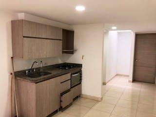Una cocina con fregadero y nevera en Se vende hermoso apartamento en Belen fatima