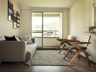 Una sala de estar llena de muebles y una ventana en Apartamento en Venta BELLO