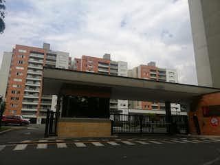 Una calle de la ciudad llena de muchos edificios altos en Apartamento en Venta SURAMERICA