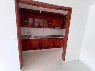 Un cuarto de baño con lavabo y un espejo en Casa en Venta VEREDA LOS ALTICOS SAN ANTONIO DE PEREIRA