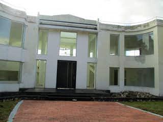 Una fila de ventanas en el edificio de ladrillo en Casa En Venta En Chia Sindamanoy