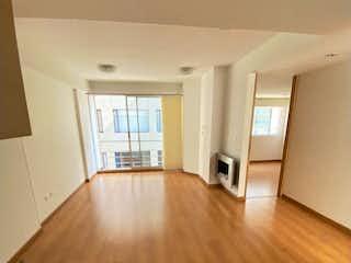 Una sala de estar con suelos de madera y suelos de madera en Apartamento en venta Ubicado en Contador