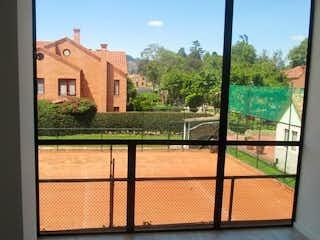 Una vista de una ciudad desde una ventana en Apartamento En Venta En Chia Entreverde