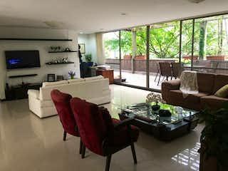 Una sala de estar llena de muebles y una televisión de pantalla plana en Apartamento en venta en Barrio Colón 206m² con Zonas húmedas...