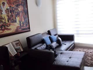 Una sala de estar llena de muebles y una pintura en Casa En Venta En Bogota Barrancas Norte