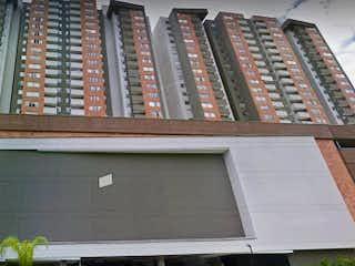 Un gran edificio de ladrillo con una gran ventana en Ed Porto Alegre