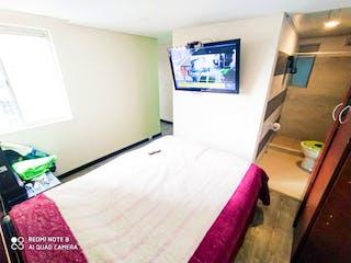 Una cama sentada en una habitación junto a una ventana en Apartamento en venta en La Coruña de tres habitaciones