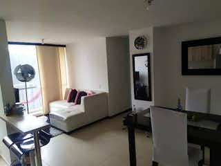 Una habitación de hotel con una cama y un televisor en Apartamento en Venta CABAÑITAS