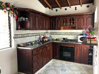 Cocina con fogones y microondas en Apartamento en venta en La Magnolia de 3 hab. con Balcón...