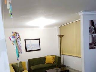 Una sala de estar llena de muebles y una chimenea en Se Vende Apartaestudio en Laureles, Medellin