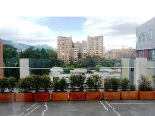 Una vista de una calle con un edificio en el fondo en VENDO APTO EN EL CONTADOR