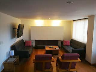 Una sala de estar llena de muebles y una televisión de pantalla plana en Apartamento en venta en Contador de 110m²