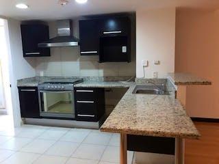 Una cocina con una estufa de fregadero y microondas en Departamento en Venta en Grand Polanco