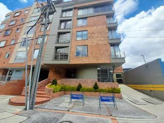 Un edificio con un letrero en la calle en Apartamento En Venta En Bogota