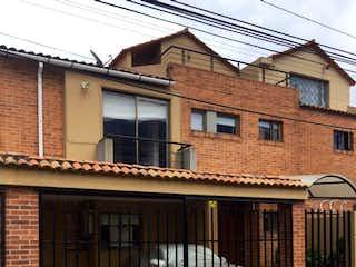 Un edificio de ladrillo con un edificio de ladrillo grande en Casa En Venta En Cota