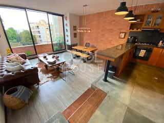 Una sala de estar llena de muebles y una chimenea en Apartamento Dúplex en Venta en Chico Reservado