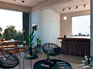 Una sala de estar llena de muebles y una televisión de pantalla plana en zamora 15
