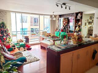 Una sala de estar llena de muebles y un árbol de navidad en Venta Apartamentos en Santa Teresa - Usaquén