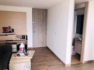 Cocina con nevera y horno de fogones en Apartamento en venta en San José de dos habitaciones