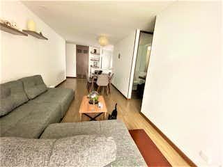 Una sala de estar llena de muebles y una televisión de pantalla plana en Apartamento en venta en La Castellana, 67m²