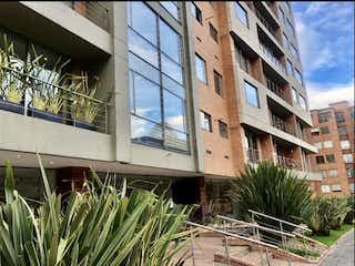 Un edificio alto sentado al lado de un edificio alto en Vendo aparta estudio loft, Cedritos, 97M2, 2baños, 2garajes MG
