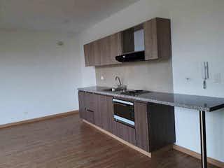 Una cocina con una estufa de fregadero y microondas en APARTAESTUDIO con BALCON en Torcoroma-Usaquén.GG