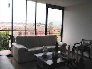 Una sala de estar llena de muebles y una ventana en Apartamento en venta en La Balsa de dos habitaciones