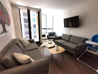 Una sala de estar llena de muebles y una televisión de pantalla plana en  SE  VENDE APARTAMENTO EN CEDRITOS