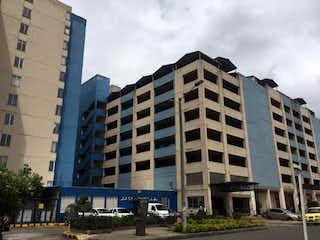 Un edificio alto sentado al lado de un edificio alto en VENTA APARTAMENTO BOGOTA SAN MIGUEL