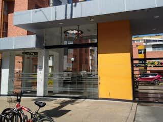 Una bicicleta estacionada delante de un edificio en Apartamento en Venta HAYUELOS